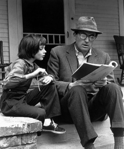 atticus is a great father Heather, this makes me want to read the novel and watch the movie again, always the sign of a great post gary cooper in high noon reminds me of atticus finch, although he's not a father, but still the strong, silent type who's not a womanizer.